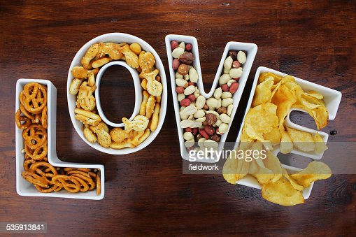 Love snacks Snacks in Love letter bowls on dark wood : Stock Photo