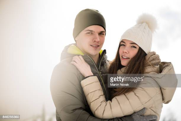 Love teen couple hugging and looking at camera