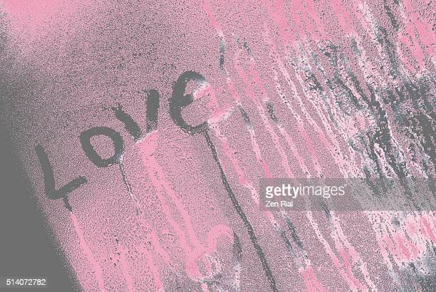 Love Text written on window condensate abstract on gray and pink
