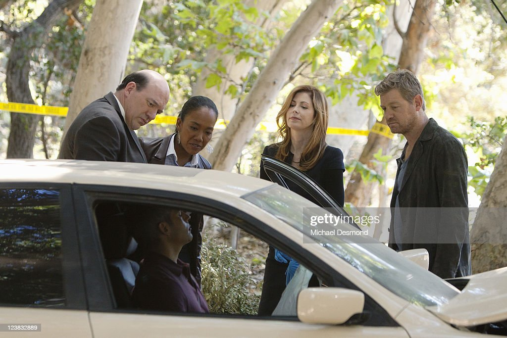 PROOF - 'Love Thy Neighbor' - When a car careens out of control over an embankment, killing a middle-aged man in the driver's seat, Megan learns that all is not well on a pretty suburban cul-de-sac. Looking past the perfect picket fences, she and her team are startled by the lives spinning out of control and the ever-changing suspect roster, on the Season Premiere of 'Body of Proof,' TUESDAY, SEPTEMBER 20 (10:01-11:00 p.m., ET) on the ABC Television Network. (Photo by Michael Desmond/ABC via Getty Images)JOHN