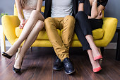 Love triangle, conceptual of a threesome, orgy, swingers or sexual cheating