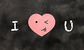 I love U message written on chalkboard with doodle face