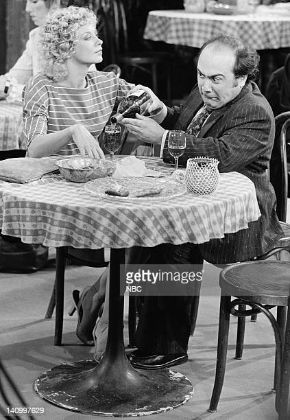 TAXI 'Love UnAmerican Style' Episode 1 Aired 9/30/82 Pictured Murphy Cross as Judy Griffith Danny DeVito as Louie De Palma Photo by NBCU Photo Bank
