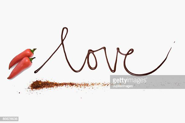 Love written in chocolate with chiles and chile powder