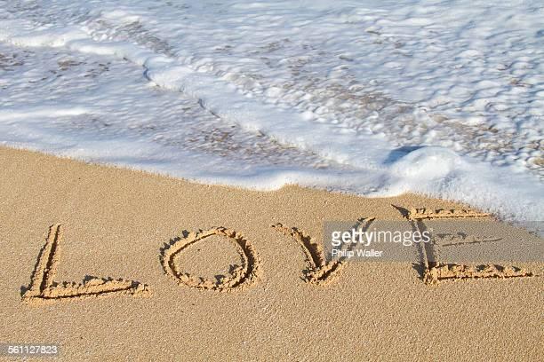 Love, written in sand, close-up