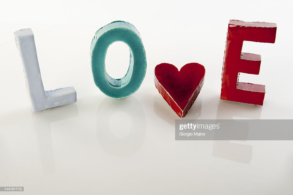 'Love' written with ceramic letters and a heart : Stock Photo