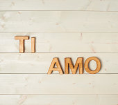 Ti Amo meaning I Love You in Italian written with the block letters over the wooden background