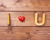 I love you written as I, Heart, U over the wooden background, Valentine's day composition