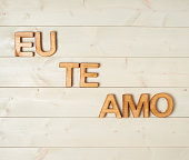 Eu Te Amo meaning I Love You in Portuguese written with the block letters over the wooden background