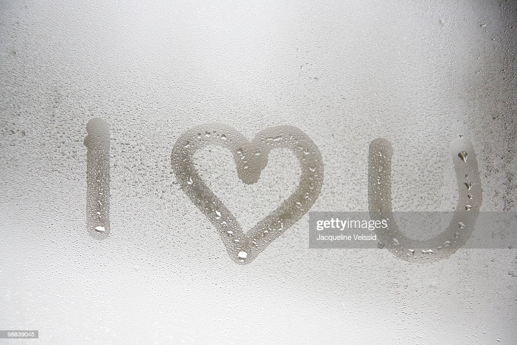 I love you written on steamed window : Stock Photo
