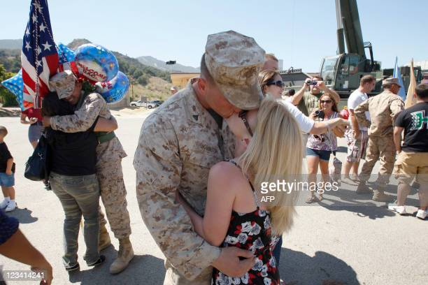 Loved ones are reunited as approximately 270 US Marines and sailors with Regimental Combat Team 1 return from a 12month deployment to Afghanistan on...