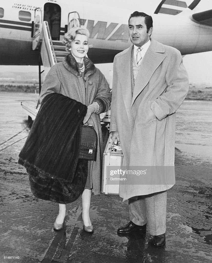 Lovely actress Zsa Zsa Gabor and actor Tyrone Power alight at Idlewild Airport November 17th after a sleeper flight via TWA from Los Angeles. Zsa Zsa is here for television appearances and Power for rehearsals of the stage play, 'The Dark is Light Enough.'