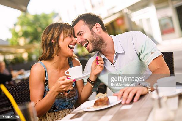 Lovely affectionate couple having fun together in a cafe.