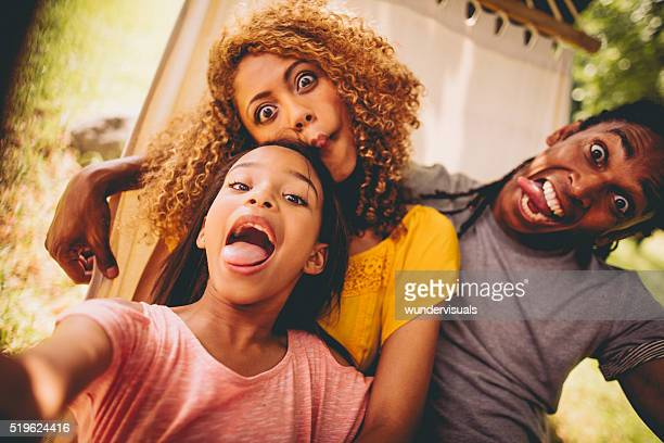 Lovely African-American family making silly faces and posing