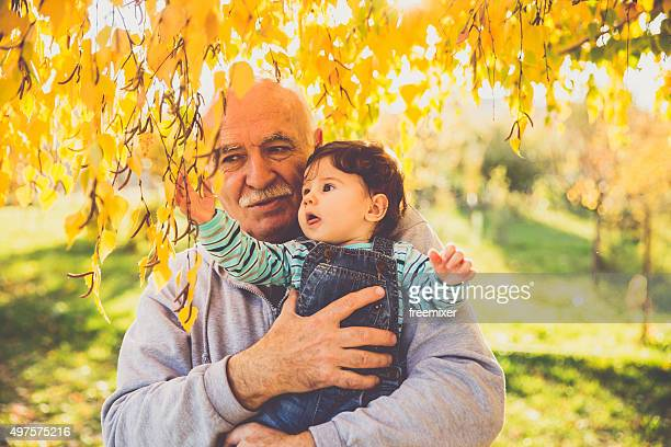 Lovely baby and his grandfather