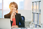 Portrait of smiling attractive business woman in office