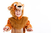 Happy little girl dressed up in lion costume for carnival (space for text)