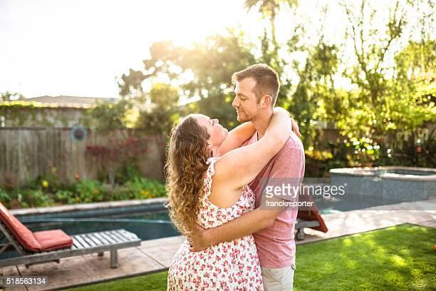 lovely couple flirting at sunset