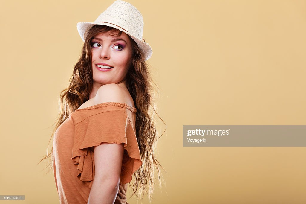 Lovely girl in summer clothes bright straw hat : Stock Photo