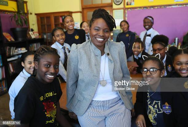 Lovely Hoffman a middle school teacher at the Helen Y Davis Leadership Academy in Dorchester center poses with some of the students when worked with...