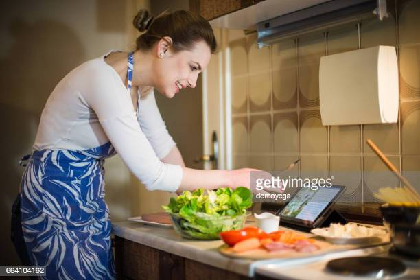 Lovely lady preparing healthy food in the kitchen