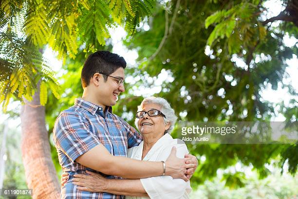 Lovely latin grandmother and grandson embracing