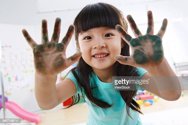 A lovely little girl hand full of pigment