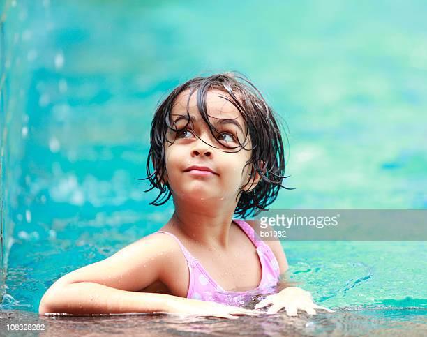 lovely little girl in the swmming pool