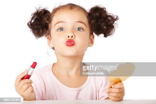 Lovely little girl making makeup