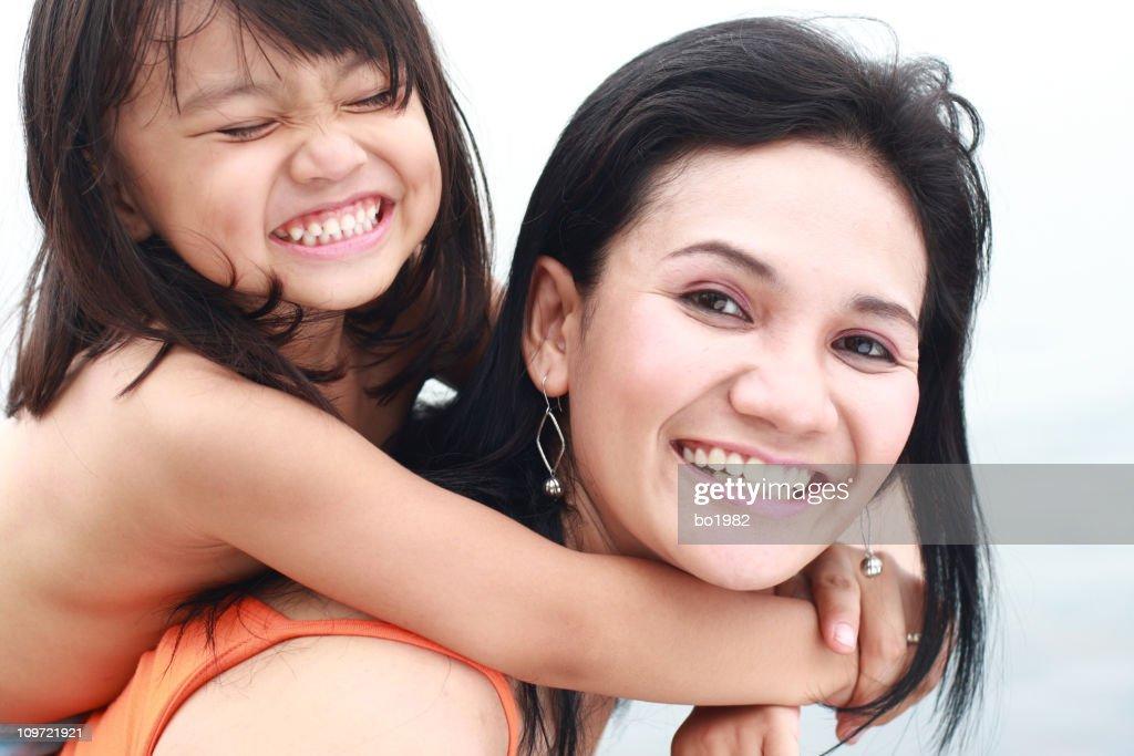 lovely little girl on her mom's shoulder : Stock Photo