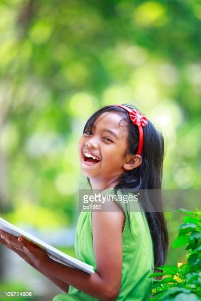 lovely little girl reading book