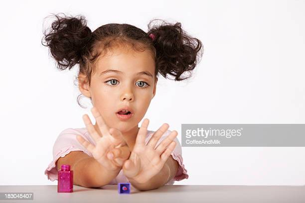 Lovely little girl with manicure