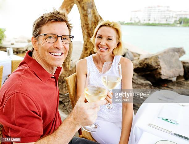 Lovely Mature Couple Enjoying Wine in a Restaurant