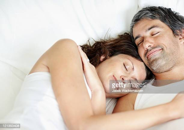 Lovely middle aged couple sleeping