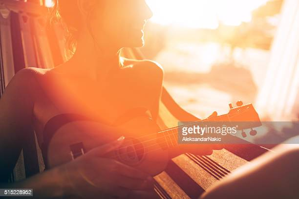 Lovely musician in the hammock
