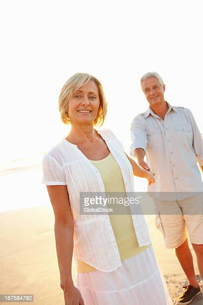 Lovely senior couple having fun on the beach