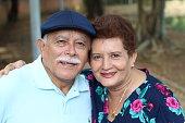 Lovely senior Hispanic couple close up.