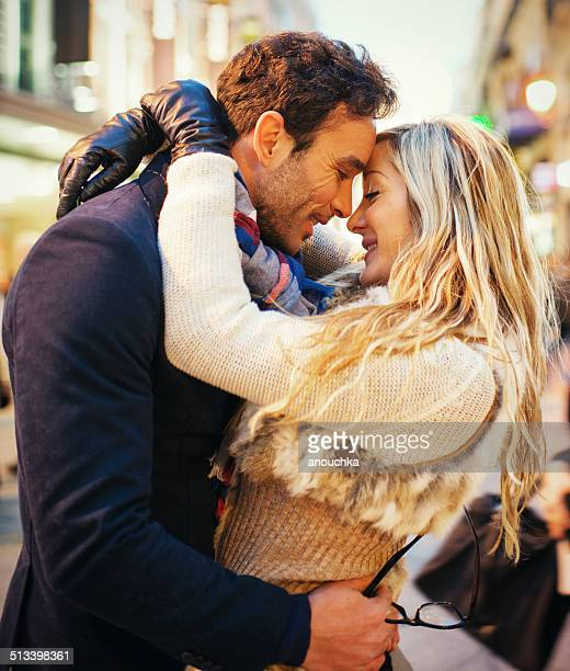 Lovely Spanish couple embracing on Madrid street