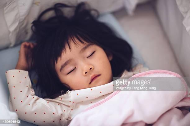 Lovely toddler girl sleeping