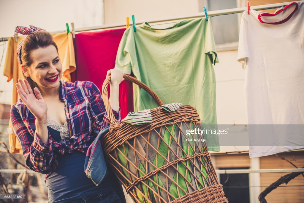Lovely vintage style lady waving from her back yard : Stock Photo