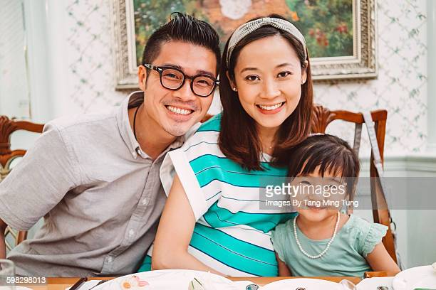 Lovely young family portrait in a restaurant
