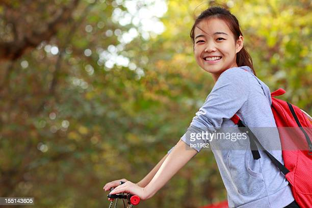 lovely young girl on bike smile at camera