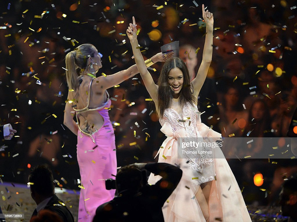 Lovelyn Enebechi (R) celebrates after winning the final of 'Germany's Next Top Model by Heidi Klum' TV show at SAP Arena on May 30, 2013 in Mannheim, Germany.