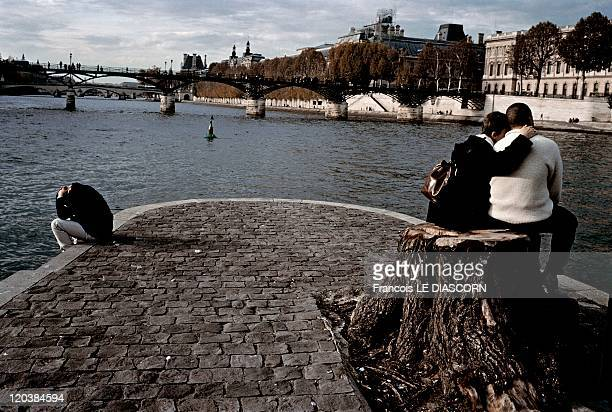 Lovers at Seine river side in Paris France Lovers at Vert Galant square on the banks of the Seine river