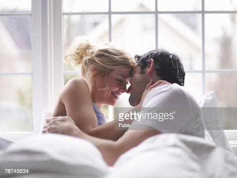 Lovers Cuddling in Bed