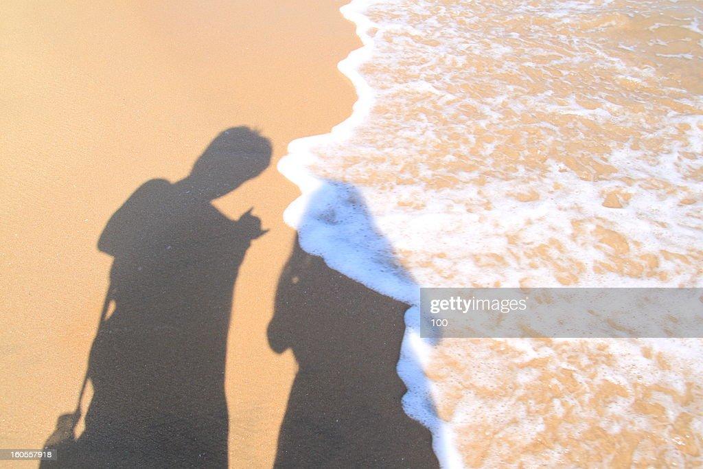 lovers' shadow on the beach : Stock Photo