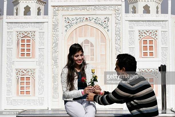 Lovers take selfies in front of the Taj Mahal shaped structure as they celebrated Valentine's Day at The Great India Place mall on February 14 2015...