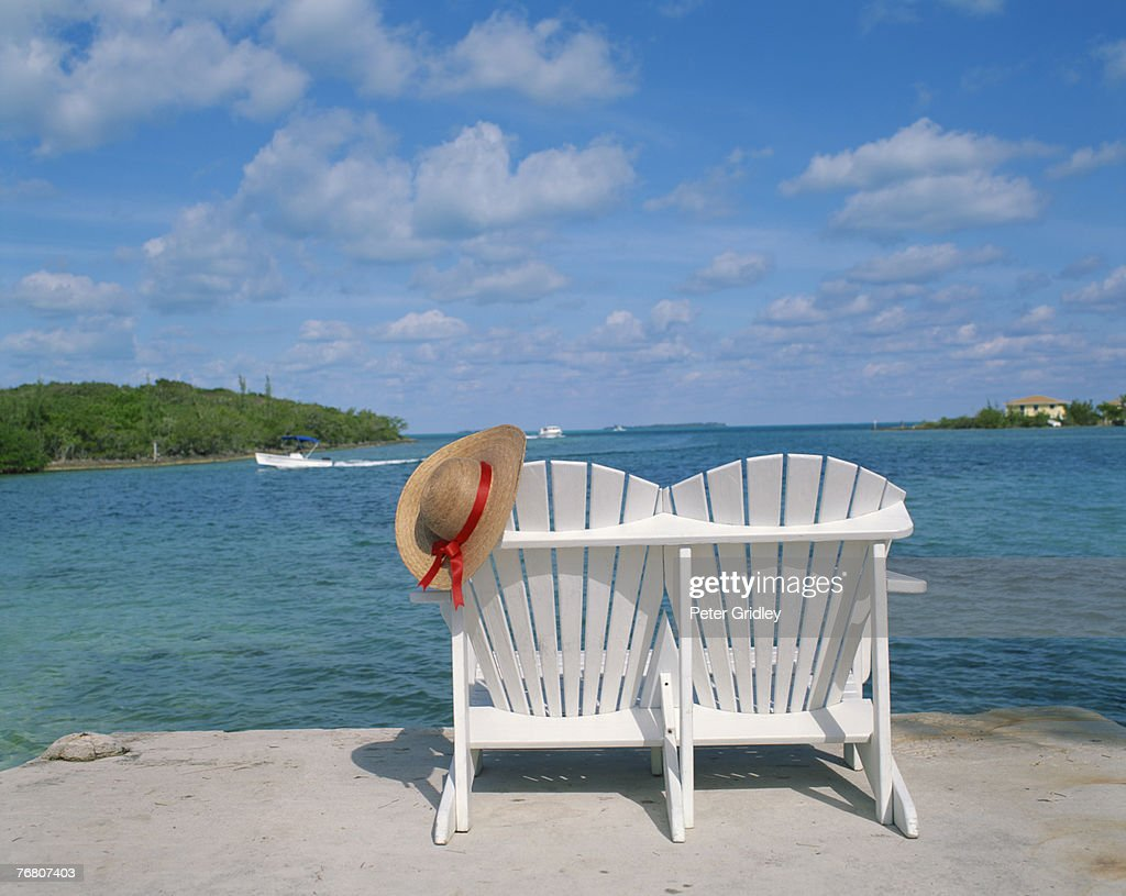 Loveseat with hat overlooking water