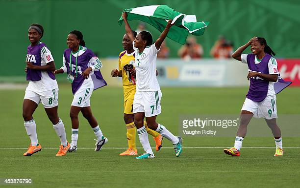 Loveth Ayila of Nigeria celebrate victory with teammates following the final whistle of the FIFA U20 Women's World Cup Canada 2014 Semi Final match...