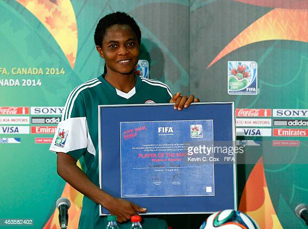 Loveth Ayila of Nigeria poses with her framed Player of the Match certificate after their 21 win in the FIFA U20 Women's World Cup Canada 2014 Group...